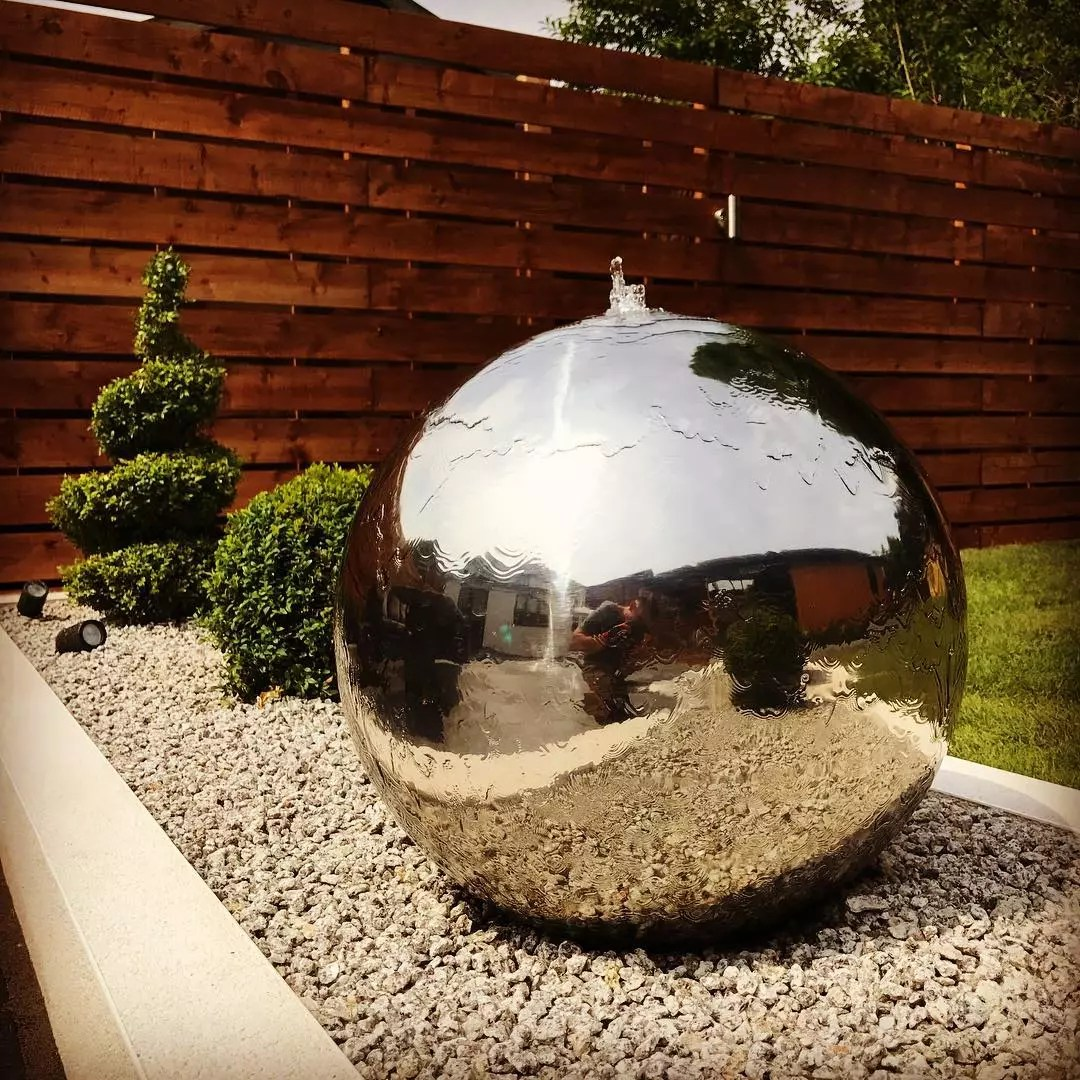 Giant silver sphere backyard fountain. Photo by Instagram user @style_earth