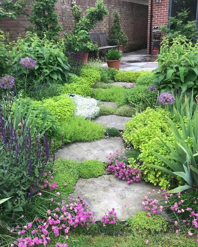 Stone pathway between bushes. Photo by Instagram user @ilovetinystuff