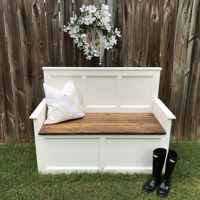 White storage bench next to fence with white flowers. Photo by Instagram user @bearded.rebel