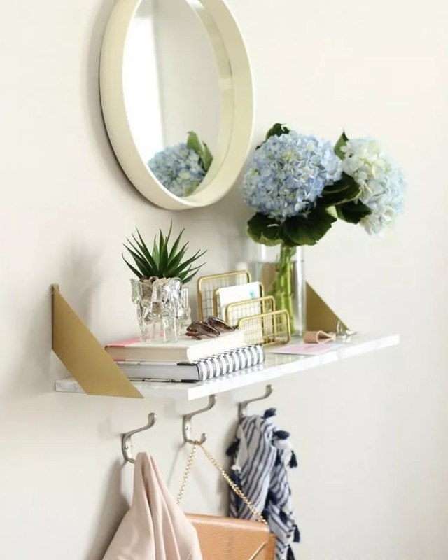 Mirror and Decorated Shelf in the Entryway of a Studio Apartment. Photo by Instagram user @medallion_corp