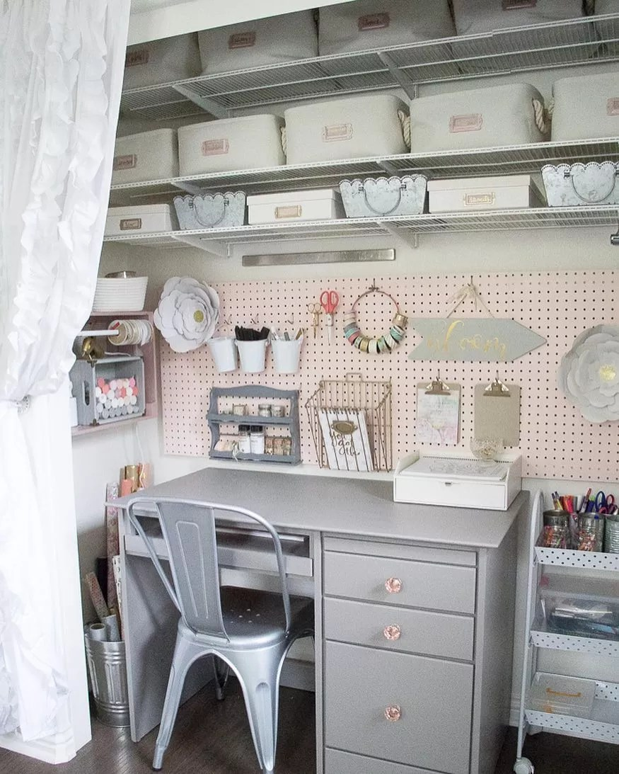 closet space used as a home office with peg board wall and storage overhead photo by Instagram user @prettyhealthyhouse