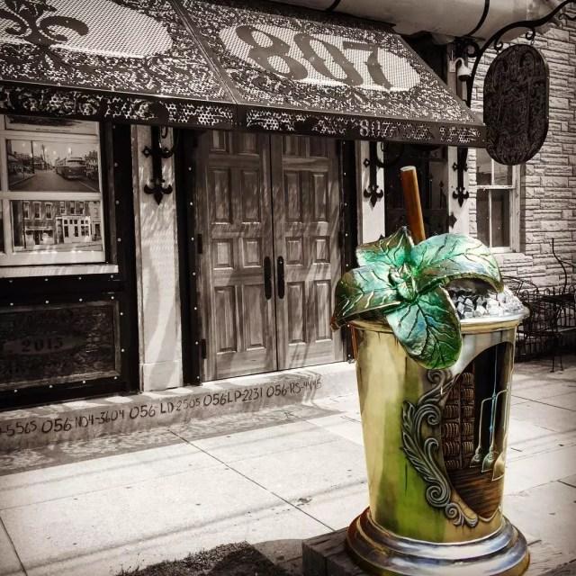 Outside street view outside of TAJ Louisville with a statue of a mint julip. Photo by Instagram user @tajlouisville