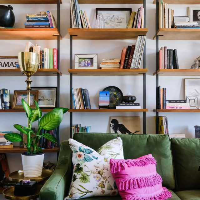 Storage shelves along walls in studio apartment. Photo by Instagram user @danielle_interior_design