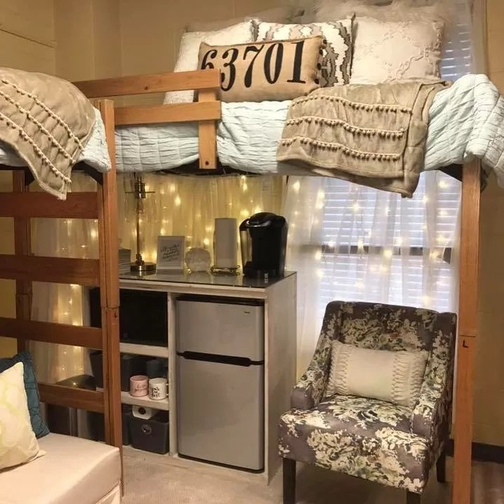 Dorm Room with Lofted Bed and Mini-Fridge Underneath. Photo by Instagram user @get_emmypaiged