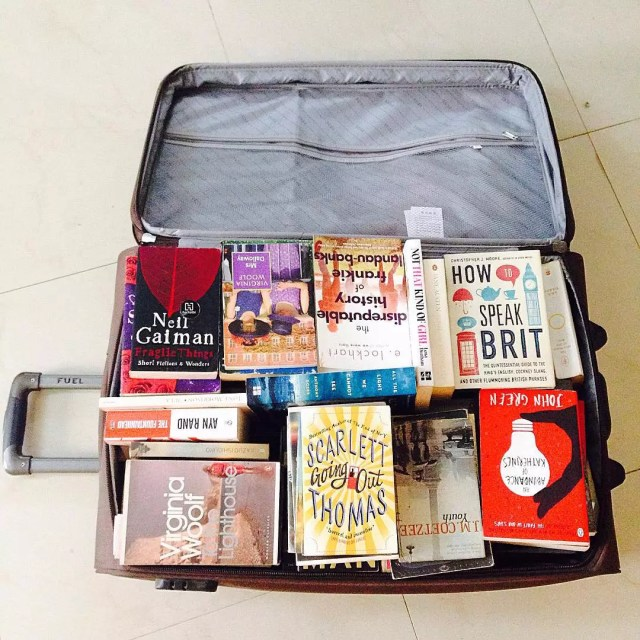Rolling Suitcase Filled with Books. Photo by Instagram user @darshbob