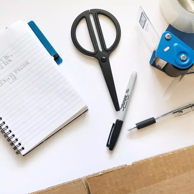 Pens, Scissors, Tape, and Other Packing Supplies. Photo by Instagram user @thesaraross