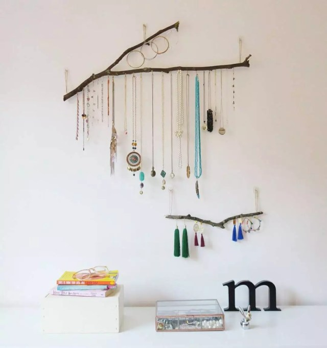 Hanging branch jewelry organizer with necklaces. Photo by Instagram user @blancometro