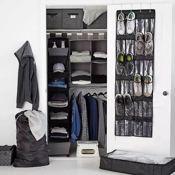 Closet with dark gray organizers for men's clothing and accessories. Photo by Instagram user @dfwdeclutterdesign