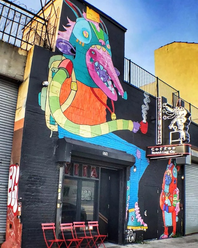 Colorful artwork on the side of a building Photo by Instagram user @walkinggirlnyc