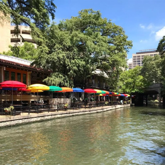 Colorful umbrellas lining the San Antonio River Walk. Photo by Instagram user @the_real_bonoboboy