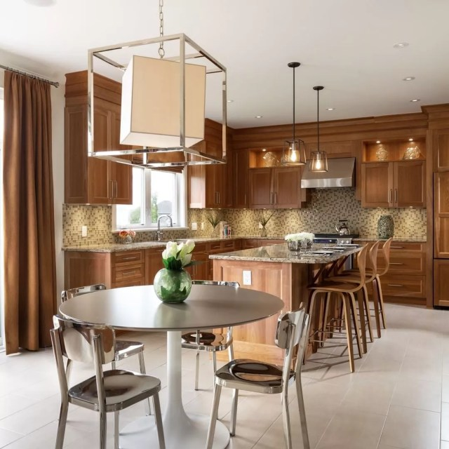 Kitchen with island and eat-in dining. Photo by Instagram user @tamarackhomes