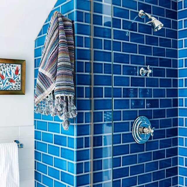 blue subway tile in shower with towel hanging photo by Instagram user @fireclaytile