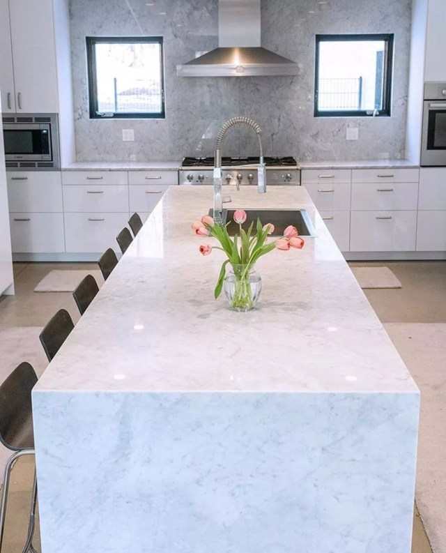 Marble kitchen island. Photo by Instagram user @colonialmarble