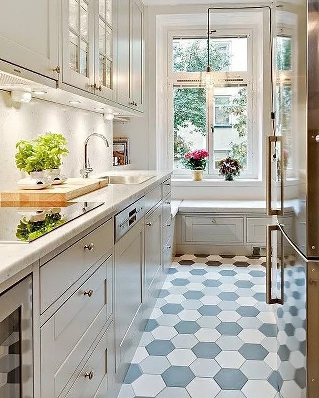 Small kitchen with big bold tile. Photo by Instagram user @metrosurfaces