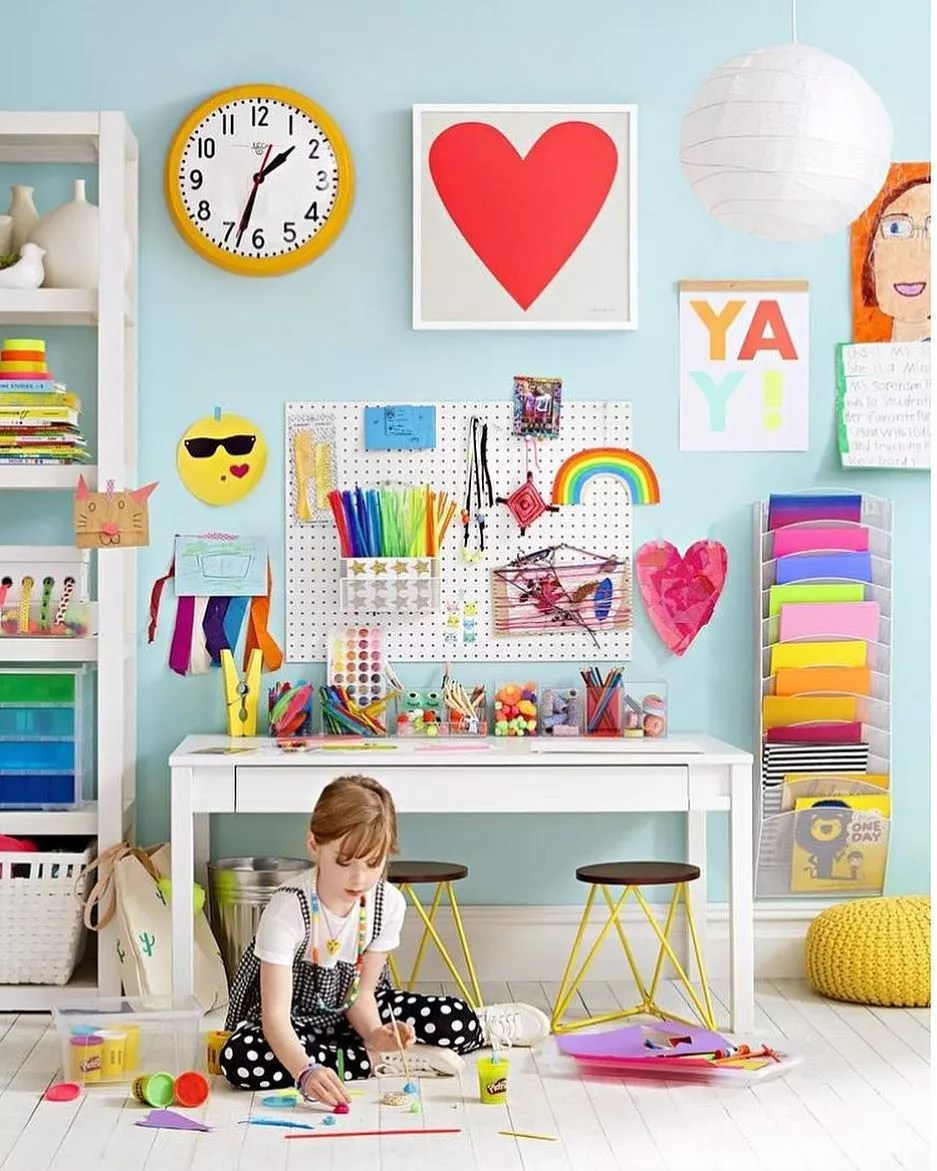 Colorful kids room with pegboard on the wall. Photo by Instagram user @tinylittlepads