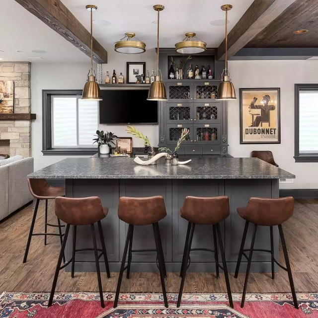 basement bar with nice overhead lighting and large island photo by Instagram user @pictureperfecthouse