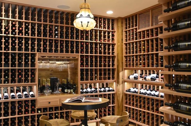 huge basement wine cellar with hundreds of bottles throughout photo by Instagram user @vintage_wine_cellars