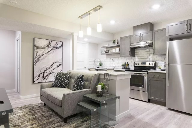basement space with finished kitchen and apartment space photo by Instagram user @landmarkhomesyeg