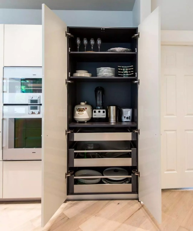 Tall kitchen cabinet with drawers. Photo by Instagram user @pednipdx