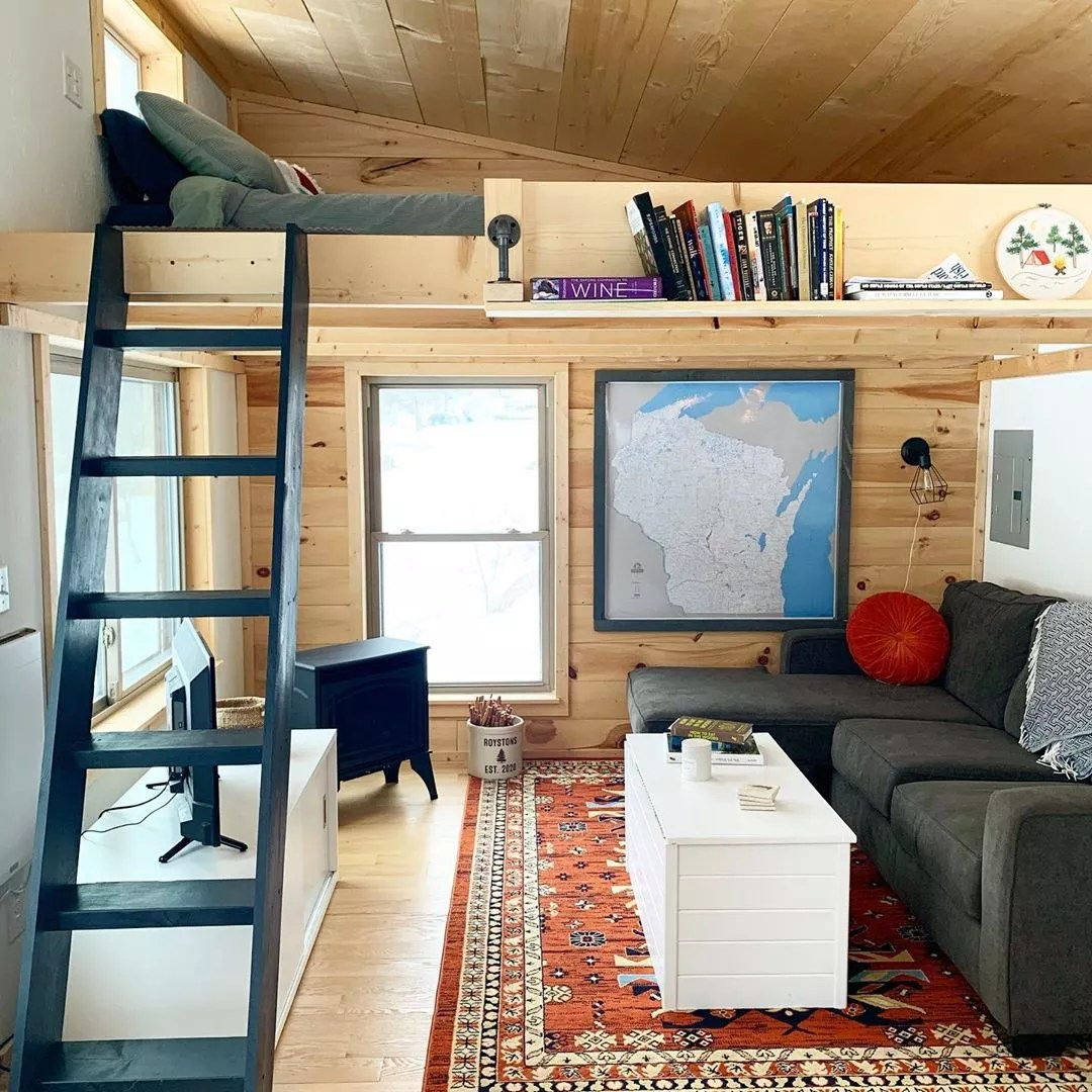 Bedroom with Lofted Bed and Ladder. Photo by Instagram user @driftlesscabindadventures