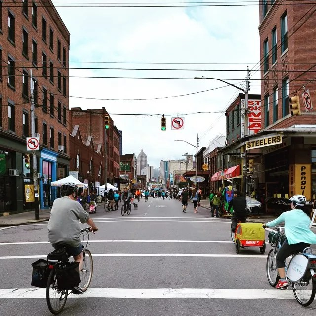 Bicyclist ride through Strip District to local shops. Photo by Instagram user @davecooperclaire
