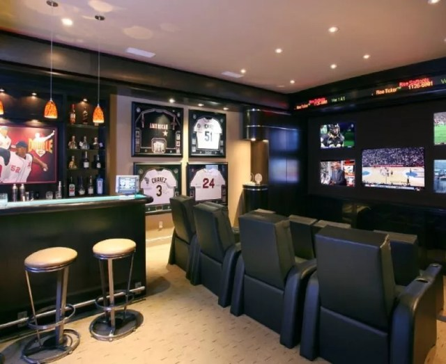Basement Decorated with Sports Memorabilia. Photo by Instagram user @delta13rack