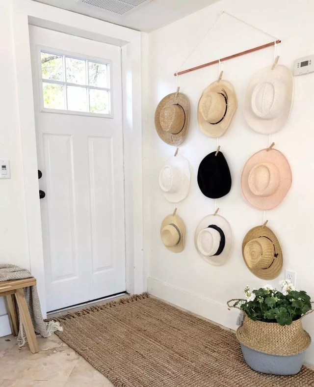 Hats hung on wall for display and storage. Photo by Instagram user @onceupona1912