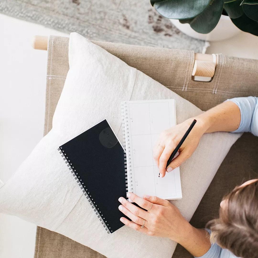 Woman writing in notebook. Photo by Instagram user @ramonaandruth