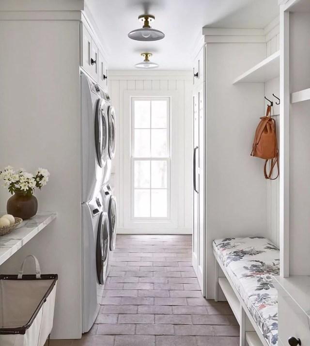 Brick floors in mudroom. Photo by Instagram user @redesignhomellc
