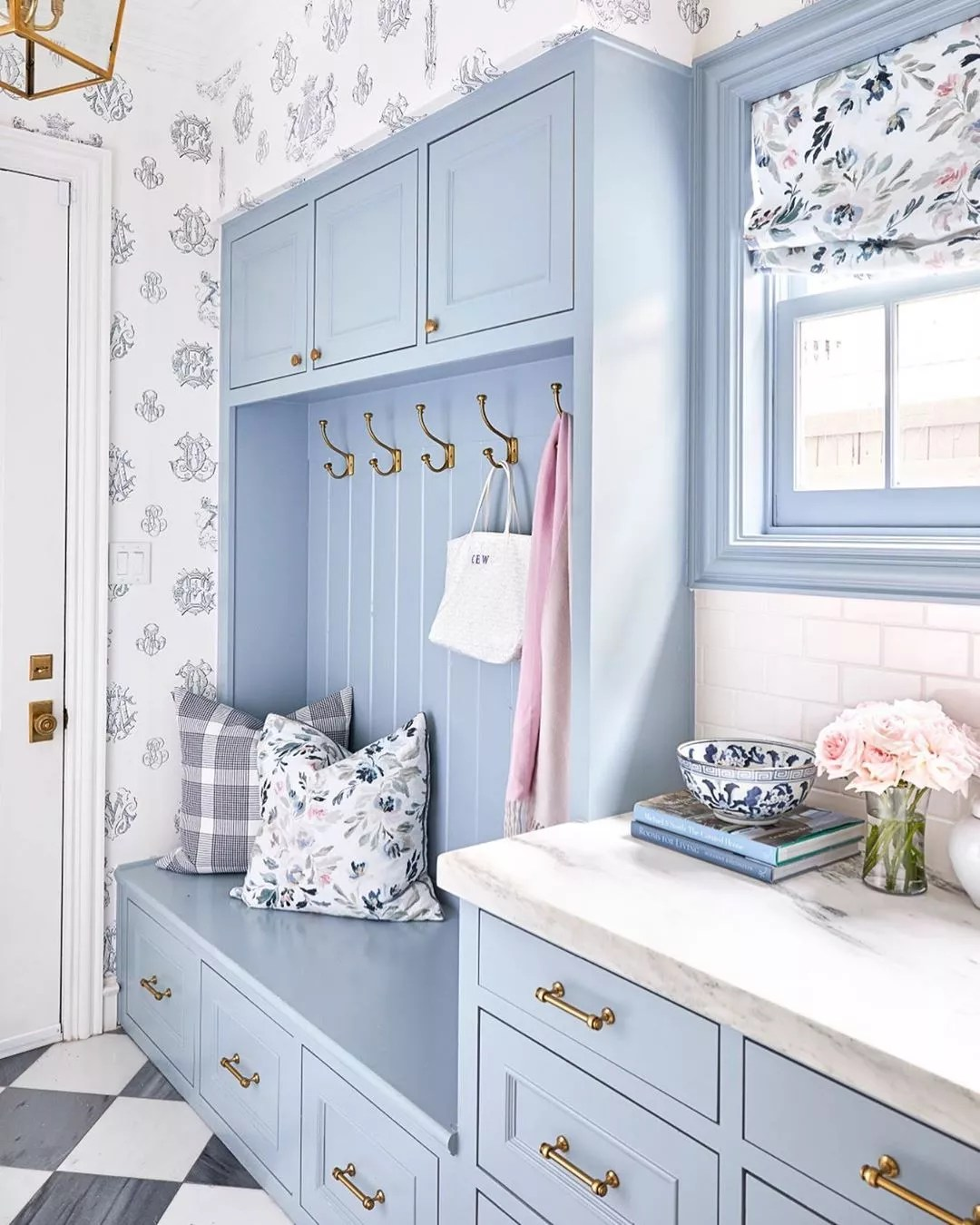 Blue and floral mudroom design. Photo by Instagram user @caitlinwilsondesign