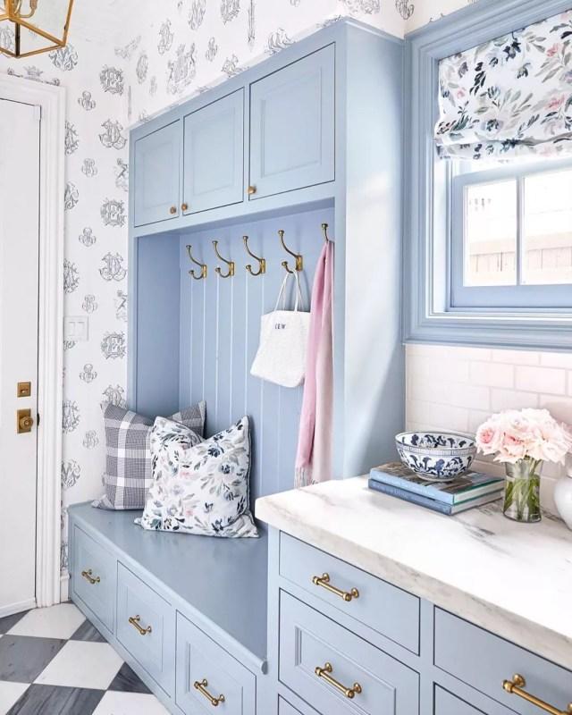 Blue and floral mudroom design. Photo by Instagram user @caitlinwilsondesign