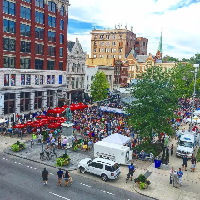 Downtown lexington, ky, street fair with people standing around photo by Instagram user @visitlex