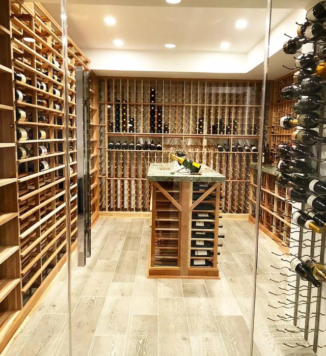 Wine Room with a Wood Tasting Table in the Center. Photo by Instagram user @mercer.built