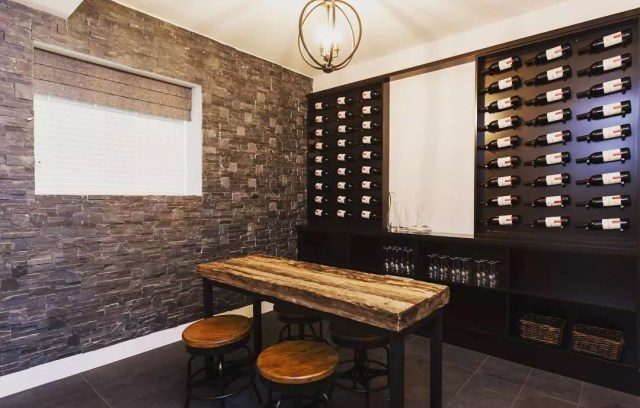 Wine Bottles Stored on the Wall of a Flex Space in Home. Photo by Instagram user @boldproperties