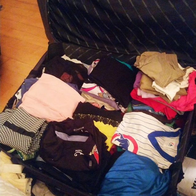 Suitcase Full of Summer Clothes to be Donated. Photo by Instagram user @shafin917