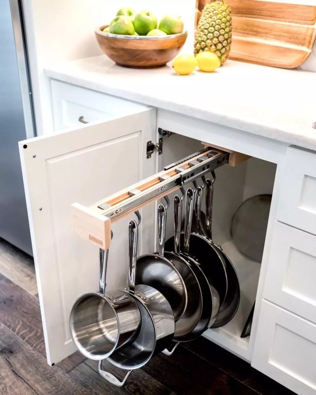Slide-out pots and pans organizer in cabinet. Photo by Instagram user @designdirectionsokc