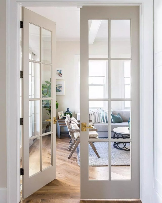 French-style doors opening into living room. Photo by Instagram user @sitamontgomeryinteriors