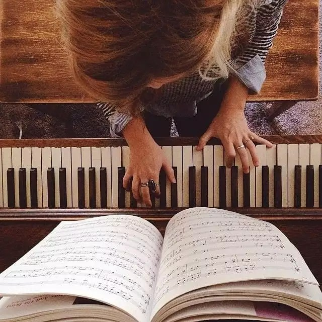 Overhead Shot of Woman Playing Piano. Photo by Instagram user @jlmusicdance
