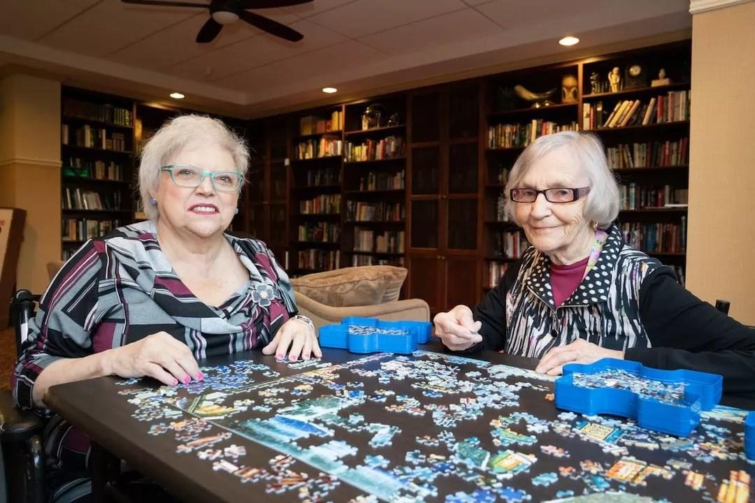 Senior Women Doing a Puzzle in a Senior Care Home. Photo by Instagram user @allseniorscarelivingcentres