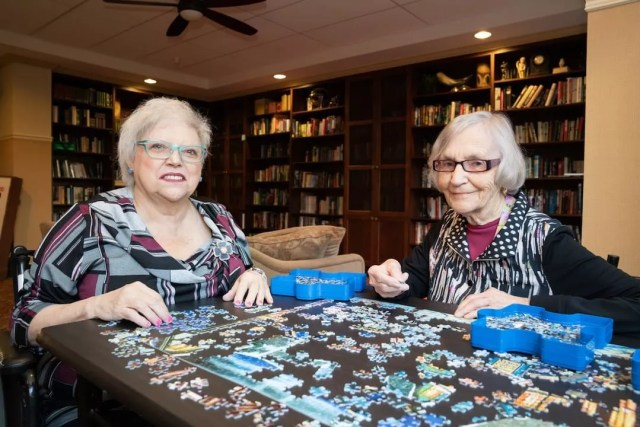 Senior Women Doing a Puzzle in a Senior Care Home. Photo by Instagram user @allseniorscarelivingcentres