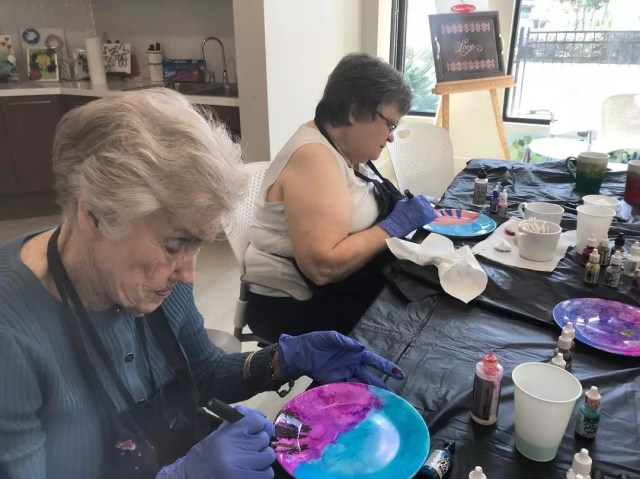 Elderly Woman Painting Pottery. Photo by Instagram user @artcellarhouston
