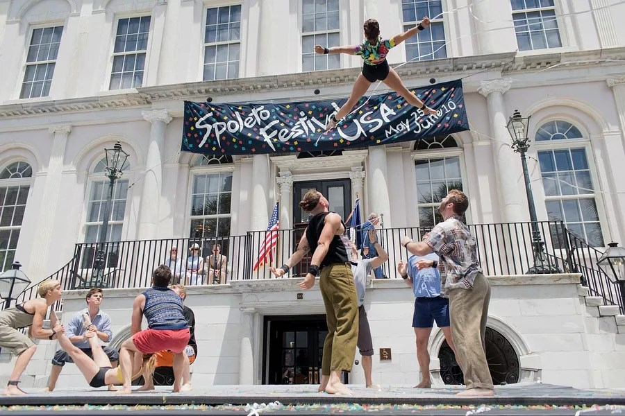 People performing acrobatic stunts in front of spectators during Spoleto Festival. Photo by Instagram user @spoletofestivalusa