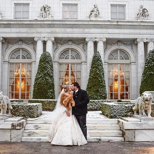 Bride and Groom Kissing at Their Wedding at Newport Mansion in Rhode Island. Photo by Instagram user @newport_mansionsweddings