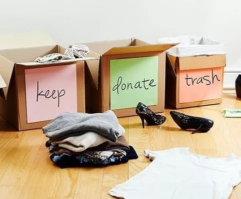 Keep, Trash, and Donate Boxes for Downsizing. Photo by Instagram user @chiropractic_family_wellness_
