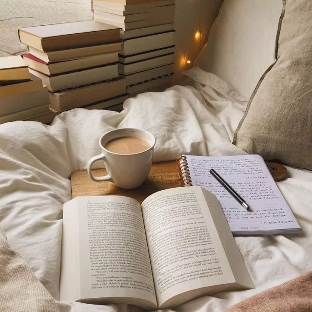 Open Book, Journal, and Cup of Coffee on a Bed. Photo by Instagram user @well_together