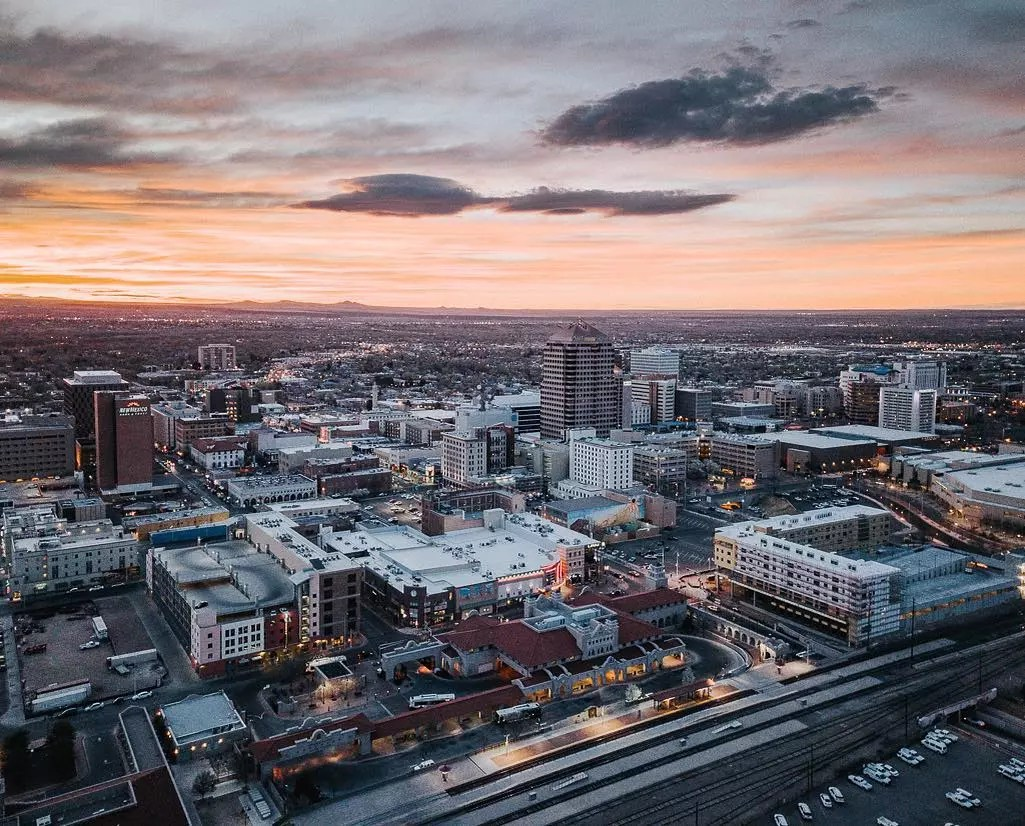 Overhead view of downtown Albuquerque at dusk. Photo by Instagram user @zcokes