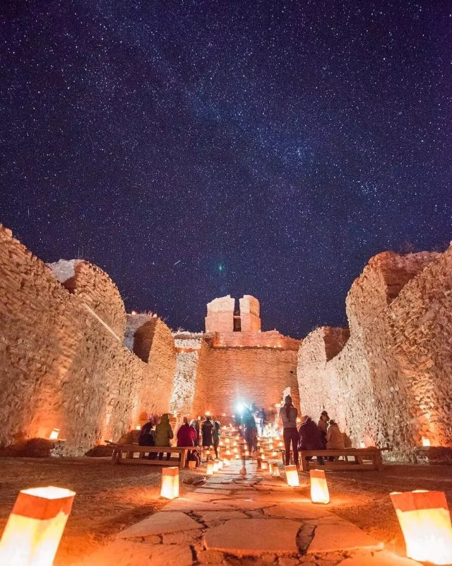 Visitors look at the clear night sky from inside the ruins of San José de los Mission Church. Photo by Instagram user @visitabq