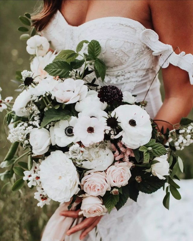 Bride Holding a Beautiful Boquet of Flowers on Wedding Day. Photo by Instagram user @thelittlealli