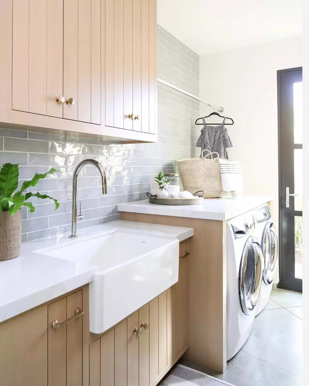 Farmhouse laundry room. Photo by Instagram user @brookewagnerdesign
