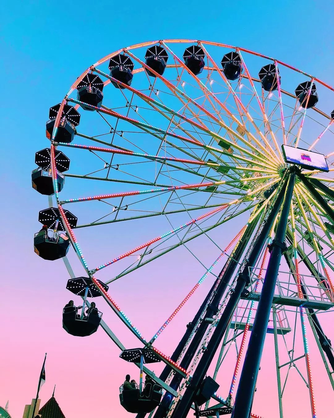 View from under large ferris wheel at dusk at North Carolina State Fair. Photo by Instagram user @sophienelise